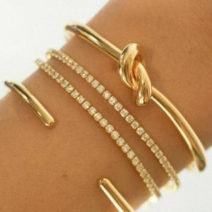 New in box   stainless steel knot bangle bracelet